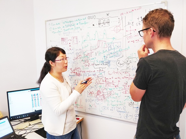 Hongmei Wu - AI Developer / Tester and Johan Malm  - AI Researcher in deep discussion.